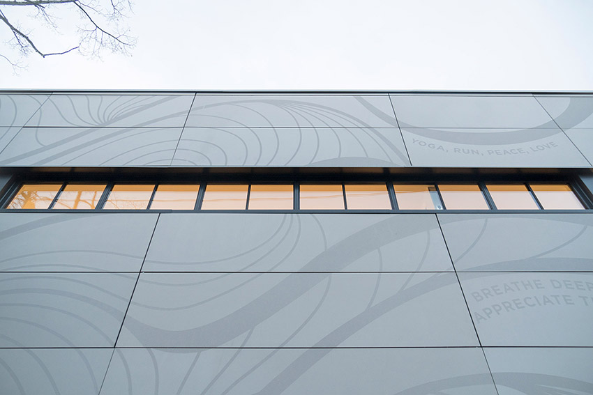 side view of lululemon commercial building showing clean design of wall and windows