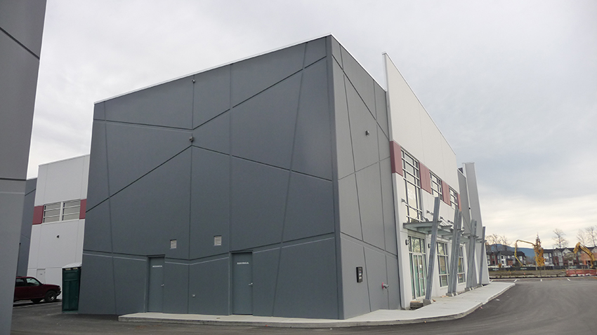 corner view showing artistic architecture features of commericial business park in port coquitlam