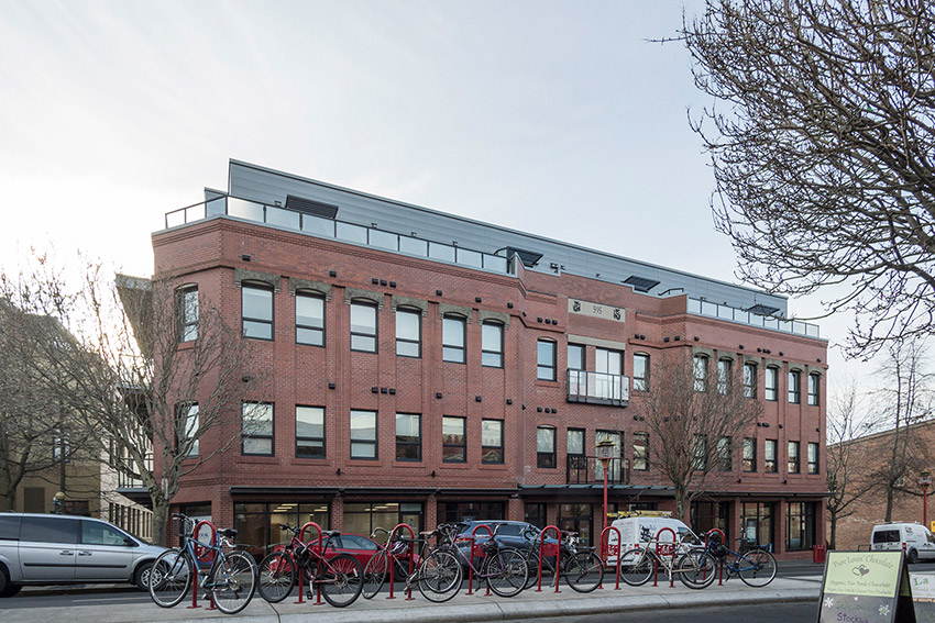 side view of heritage building restoration with bicycles parked outside