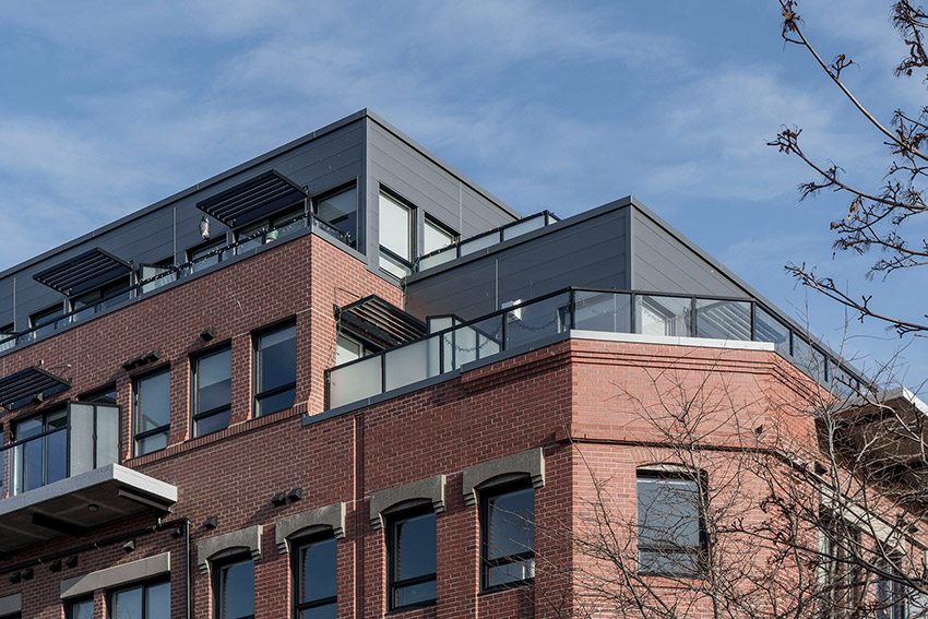 top corner view of brick building with large balconies