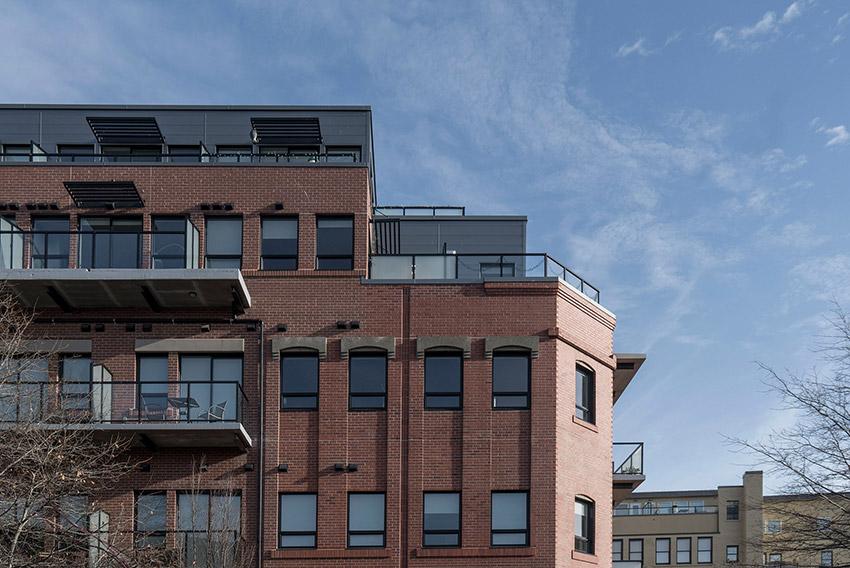 top three floors of large brick building