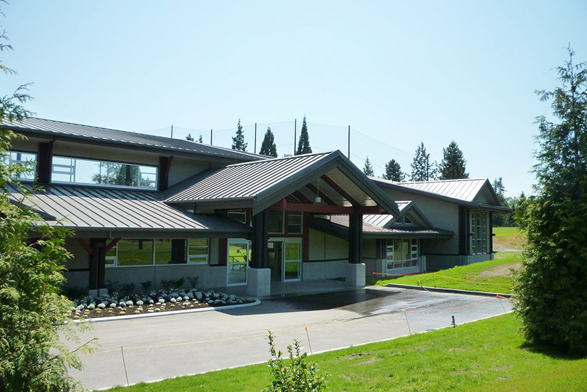 view of burnaby mountain golf centre architecture from across the driveway