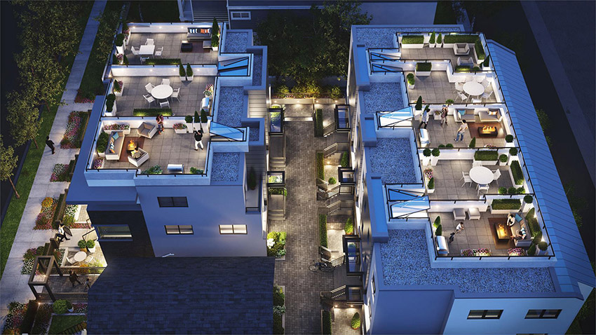 night shot of overhead residence showing roof top decks