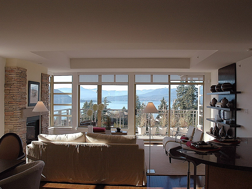 luxury townhome interior design showing white walls, clean design and gorgeous mountain and water view of howe sound